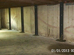 Dated picture of foundation supports on foundation wall