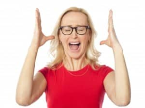 Frustrated woman with her hands in the air