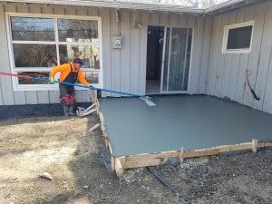 man smoothing concrete flatwork