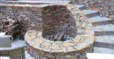 image showing fire pit uniquely designed to fit into a retaining wall and stair structure