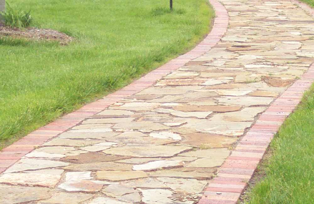 image of flagstone walkway with brick curbing